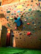 Boulderers climb Boulders