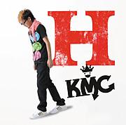 K M C