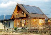 琵琶湖とログハウスと太陽光発電