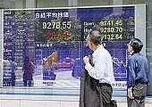 株価に興味があるふりをする